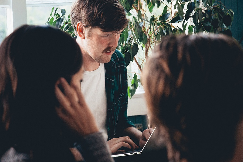Geoff House, Elise Fung, and Evan McEldowney discussing design strategies